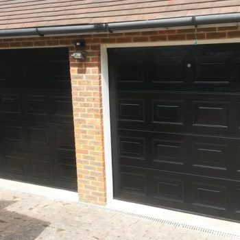Two Gloss Black Sectional Garage Doors