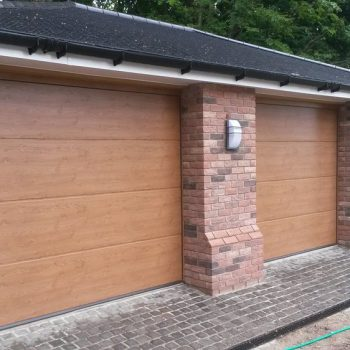 Three Wooden Sectional Garage Doors